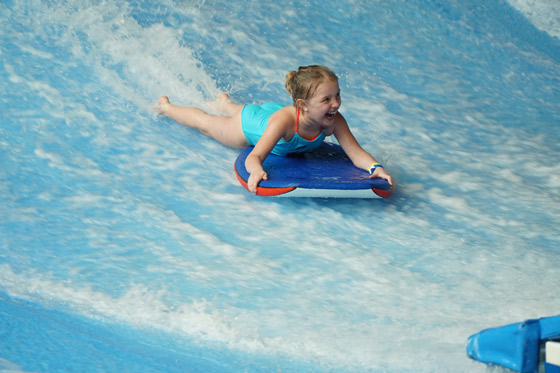 uploads/Things To Do/Gallery/flowrider/Girl-Blue-Swimsuit.jpg